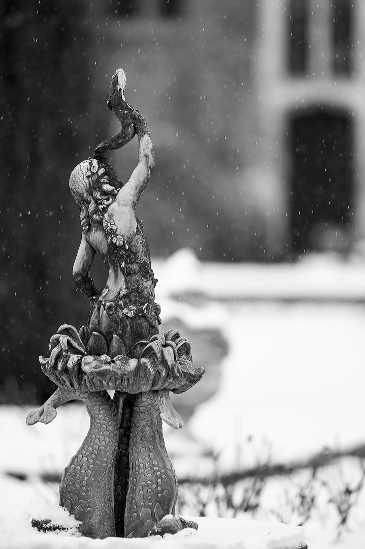 Fountain in the snow before a wedding at Hengrave Hall